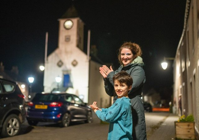 Residents of Lauder's Main street clap for the NHS last night.