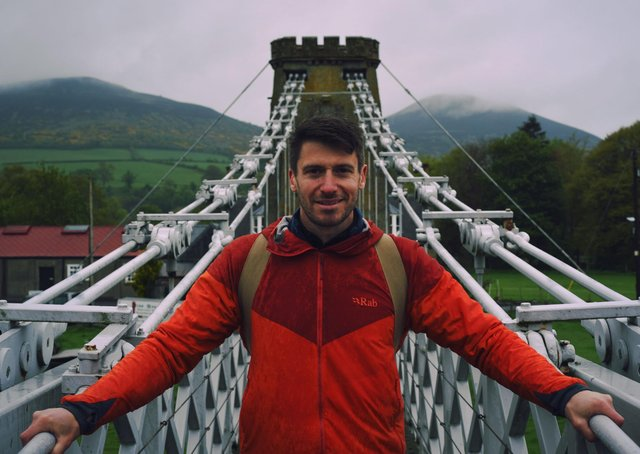 Walking Britain's Lost Railways presenter Rob Bell on the Melrose chain bridge over the River Tweed.