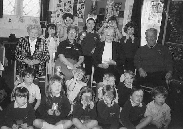 Pupils at Glendouglas Primary School pupils with local war veterans.