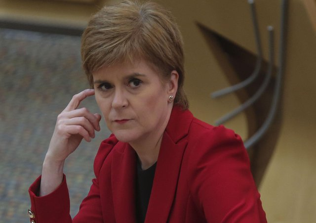 Nicola Sturgeon taking first minister's questions at the Scottish Parliament today, August 12. (Photo by Fraser Bremner/pool/Getty Images)