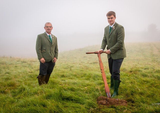 Hawick Cornet Connor Brunton, watched by acting father Joe Crawford, cutting a sod of earth at the Ca' Knowe, south of the town. Photo: ILF Imaging