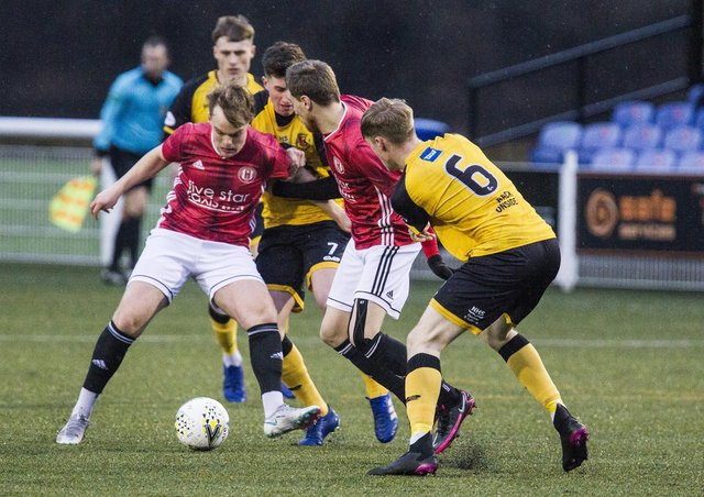 Gala Fairydean Rovers central midfielder Archie Roue up against Annan on Boxing Day. Photo: Bill McBurnie