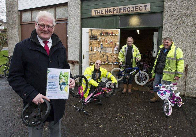Councillor Stuart Marshall at Hawick's Hapi Centre with project worker Ged Smith and volunteers, Richard Blisga and Ian Murdie. (PHOTO: BILL McBURNIE)