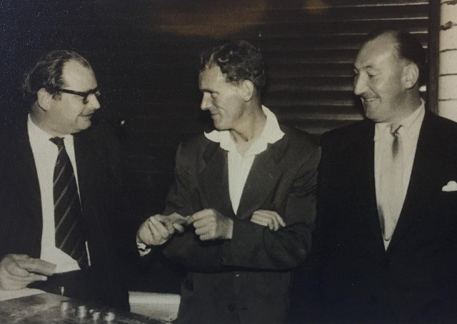 Duncan Mackinnon, left, doing what he did best, selling tickets. Can anyone name the other two gentlemen?