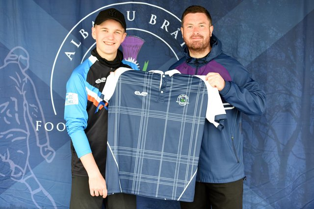 South of Scotland champion at Duns, Ali Dick, left, is presented with his international footgolf top by Scotland captain Joe McCourt.