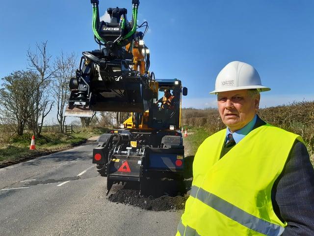 Councillor Gordon Edgar with the new JCB Pothole Pro