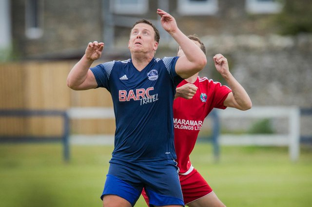 Vale of Leithen player-manager Chris Anderson in action against Hawick Royal Albert United (Photo by Bill McBurnie)