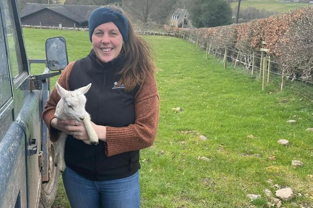 Jasmine Jackson on the farm with one of the lambs.
