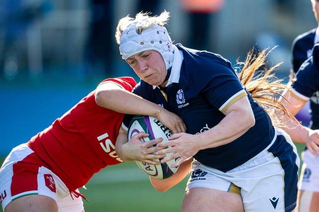 Lana Skeldon gets past a Welsh challenge