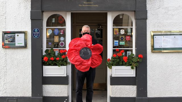 Owner Nick Henderson from the Burts Hotel in Melrose with their poppy. Photo: Douglas Hardie.
