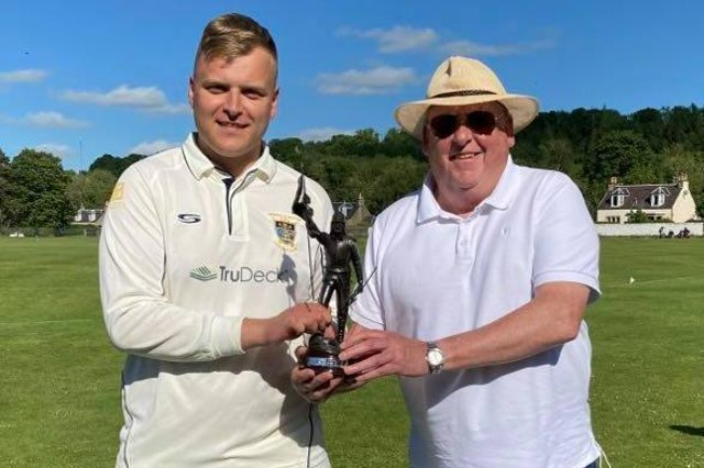 Hawick cricket captain Euan Hair, left, receives the Ronnie Simpson Memorial Trophy from Selkirk CC chairman Roger Arnold.