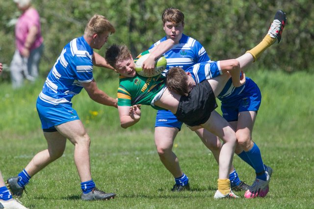 Selkirk player Seb Mackay being put under pressure by Jed Thistle at Melrose on Saturday