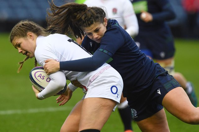 Get a grip ... Lisa Thomson, right, tackles England's Jess Breach in a Six Nations match last year (photo by Paul Devlin / SNS Group / SRU).