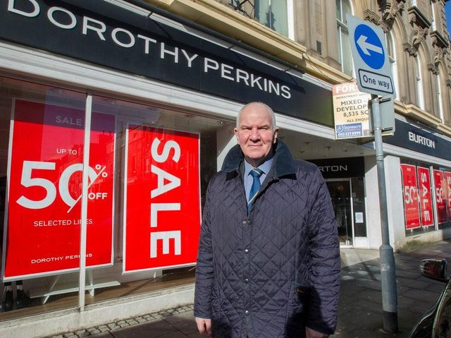 Councillor Watson McAteer beside the former Burtons and Dorothy Perkins stores.  (Photo:BILL McBURNIE)