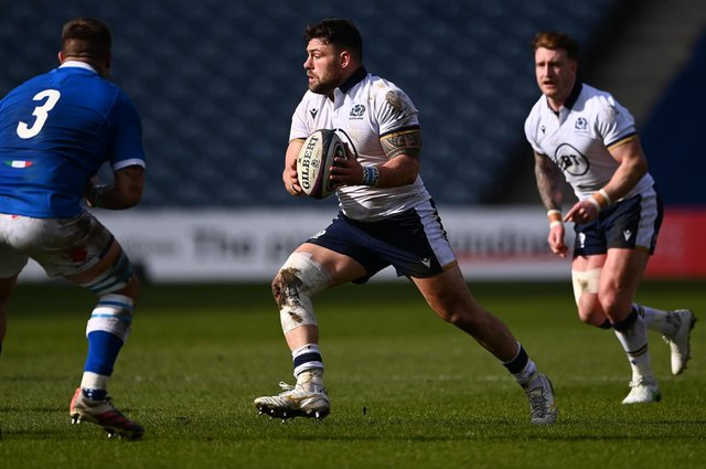 Rory Sutherland and, right, Stuart Hogg in action during the Guinness Six Nations match between Scotland and Italy at Murrayfield on March 20 in Edinburgh (Photo by Stu Forster/Getty Images)