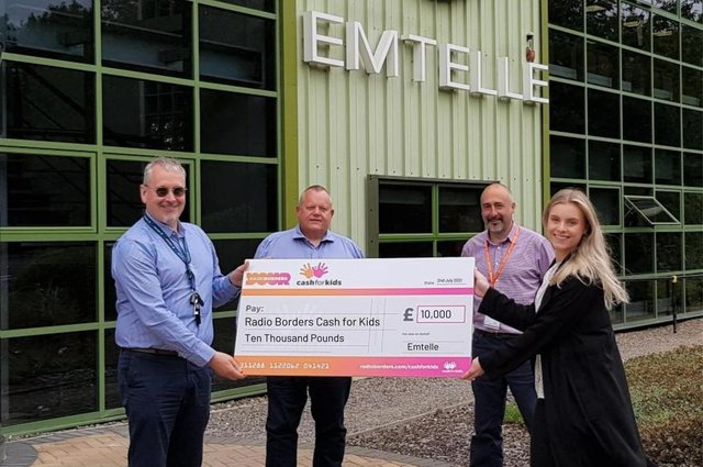 From left are: Emtelle'sBilly Rae, Tony Rodgers and Colin Kirkpatrick, with Cash for Kids charity manager Alice Edwards.