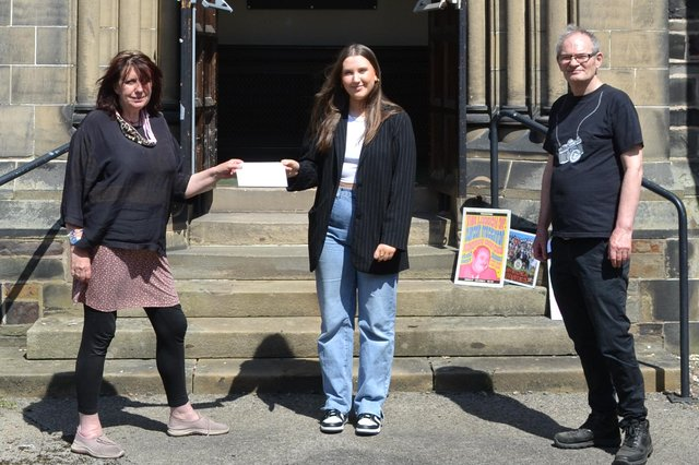 Fay Fife, front woman of the legendary Rezillos, hands over the prize to Amy Anthoney, watched by Mac Arts director David Little.
