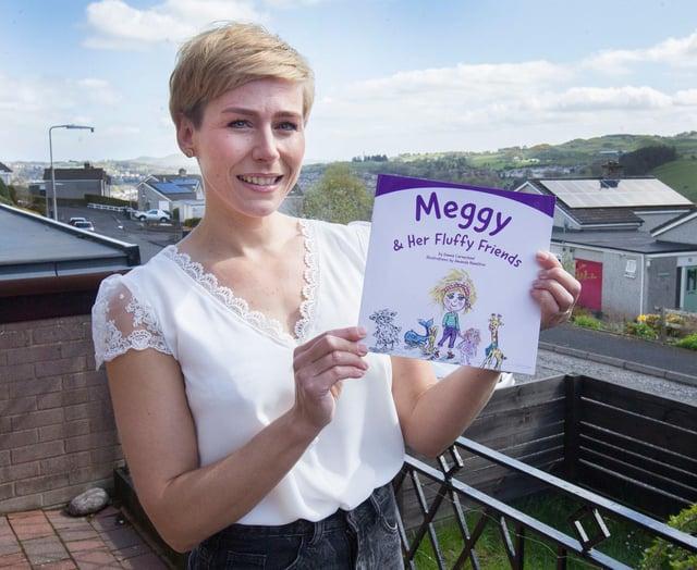 Emma with her new book. (Photo: BILL McBURNIE)