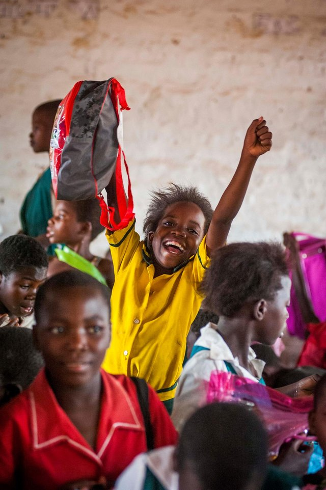 Malawi pupil Martha Payne is delighted with her backpack.