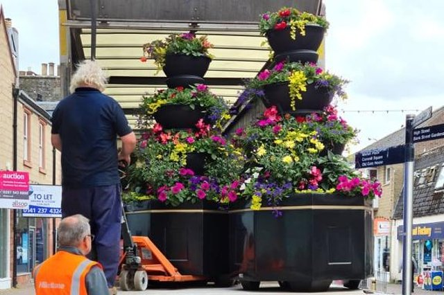 Some of the new planters being put in place in Galashiels' Channel Street and Douglas Bridge.