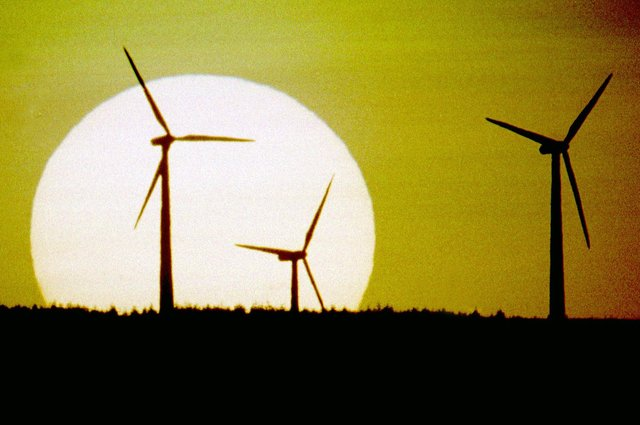 The sun sets behind Scotland's first wind farm on Hagshaw Hill near Douglas in Lanarkshire. The 26 turbine first produced electricity in 1995 and was extended to 46 turbines in 2008. It is operated by ScottishPower Renewables.