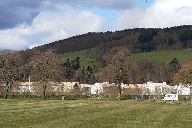 The fence which separates the gypsy travellers site from the Selkirk Youth Club rugby pitch.