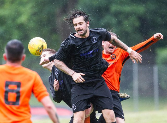 Davis Hope of Hawick Waverley rises highest in the rain in the Heads Together Cup match with Hawick United (all pictures by Bill McBurnie)