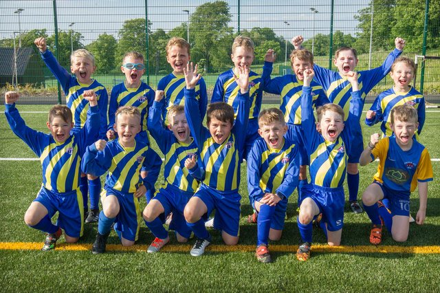 Ancrum's 2013 teams celebrating being undefeated in a community tournament in Edinburgh (Picture by Bill McBurnie)