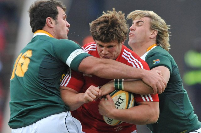 Ross Ford being tackled by Bismarck du Plessis and Wynand Olivier during the third test match between South Africa and the British and Irish Lions at Ellis Park Stadium on July 4, 2009, in Johannesburg, South Africa (Photo by Gallo Images/Getty Images)