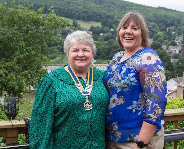 Lynda Stoddart presents her mother Elizabeth Norman with the Rotary chains of office. (Photo: BILL McBURNIE)