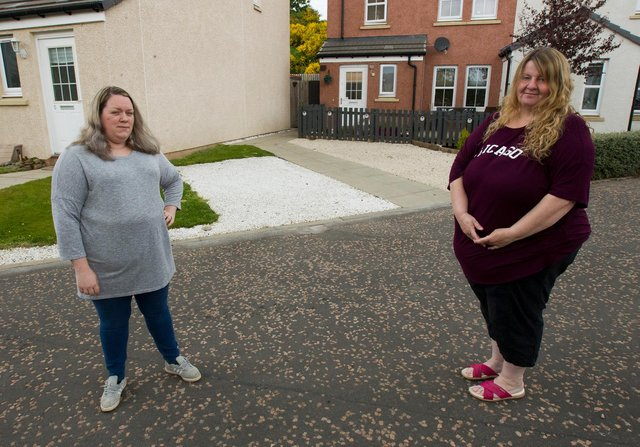 Beth Hosa and Pauline Ward beside their driveways in Coulter Avenue, Galashiels. (Photo: BILL McBURNIE)