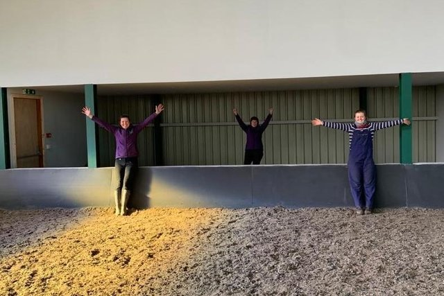 Staff at Stable Life celebrate the refurbished indoor riding school.