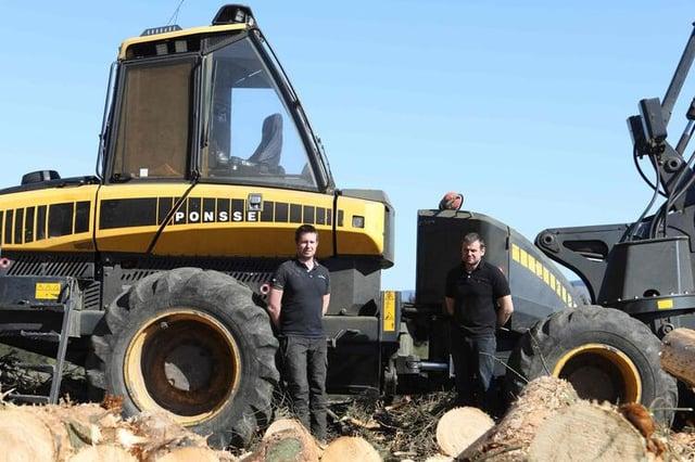 Douglas Mathison with harvester operator Michael Herdman.