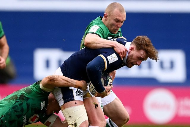 Scotland's Stuart Hogg being tackled by Keith Earls and Garry Ringrose of Ireland at Murrayfield Stadium in Edinburgh (Photo by Stu Forster/Getty Images)