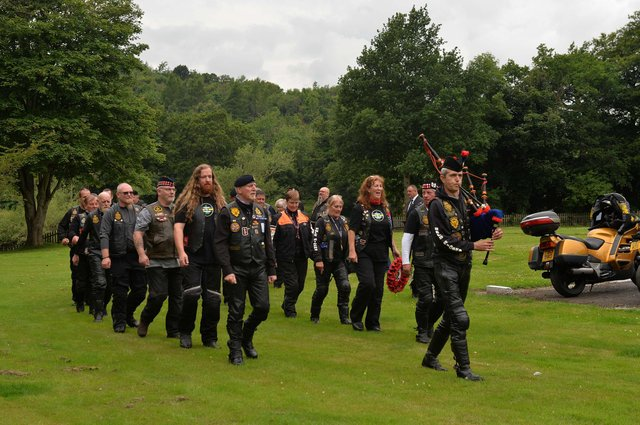 The parade of bikers are piped to the service at Dryburgh Abbey.
