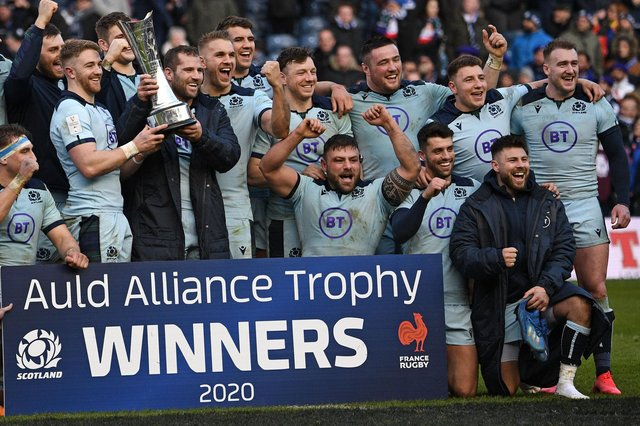 Scotland players including Stuart Hogg, back far right, and Rory Sutherland, third from right at front, celebrating with the Auld Alliance Trophy after beating France 28-17 in Edinburgh a year ago (Photo by Anne-Christine Poujoulat/AFP via Getty Images)