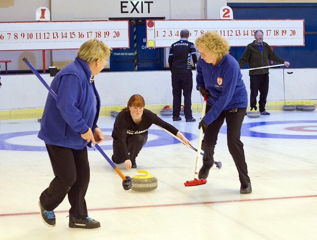Claire Livingstone delivers a stone at the Border Ice Rink. Photo: Bill McBurnie.