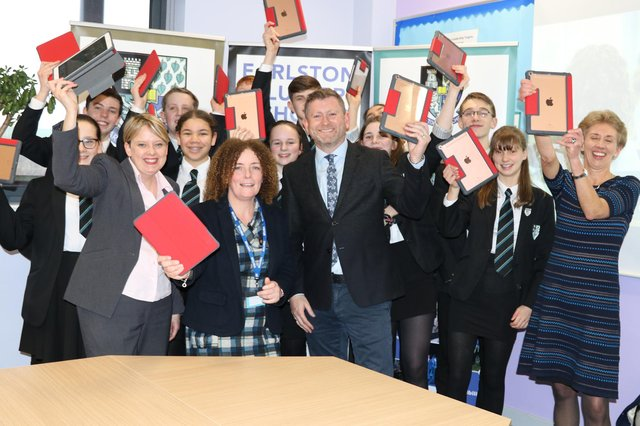 Earlston High School pupils and teachers with council leader Shona Haslam and councillor Carol Hamilton, receiving their ipads in 2019.