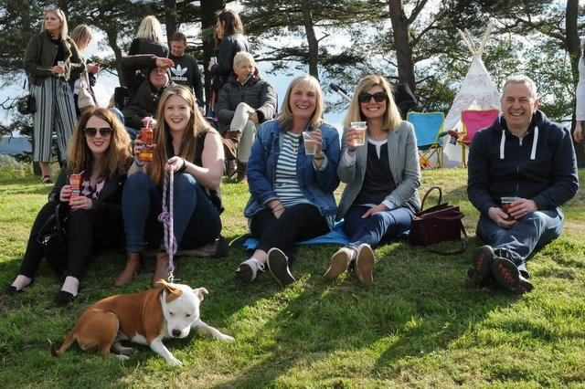 Selkirk Rugby Club vice-president David Anderson basking in glorious sunshine at 2019's sevens there with Niamh Conway, Rachel Houston, Shirley Houston, Sam Anderson and Tibbie the dog. Similar weather isn't forecast for this weekend, leading to a replacement event being put back a week (Photo: Grant Kinghorn)