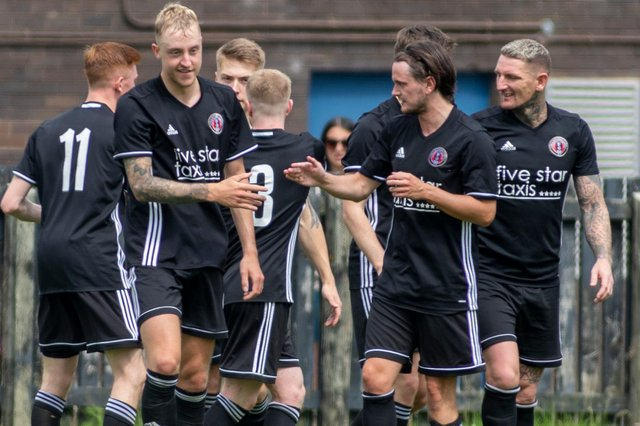 Gala Fairydean Rovers' Daryl Healy being congratulated on scoring during their 4-2 defeat by a Hearts XI yesterday (Photo: Thomas Brown)
