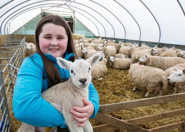 Kirsty with her flock. (Photo: BILL McBURNIE)