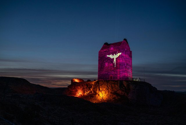 Smailholm Tower is lit up as part of Sir Walter Scott's 250th anniversary celebrations. Photo and video: Phil Wilkinson.