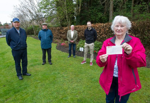 Members of Gala in Bloom, John Gray, Alaistair Waddell and Ken Hay at Bank Street with Judith Cleghorn receiving a cheque from Dalgetty's Bakery owner Craig Murray. The money was raised bu customers of the bakery. (Photo: BILL McBURNIE)