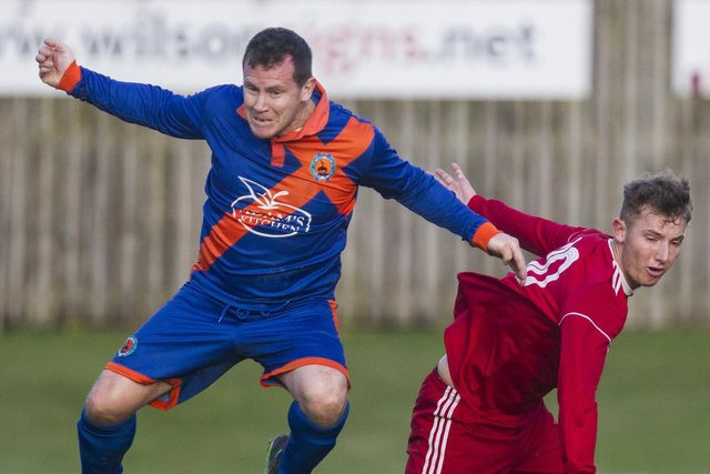 Hawick Royal Albert United's Kevin Strathdee and Peebles Rovers No 10 David Lindsay during their sides' 4-4 draw in November. Photo: Bill McBurnie