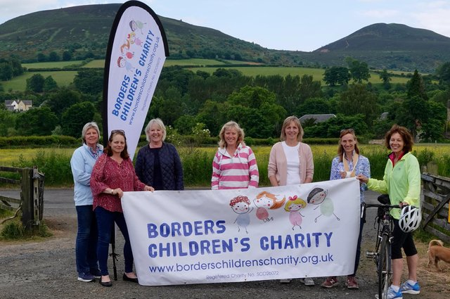 Borders Childrens Charity volunteers celebrate being named as the Buccleuch Property Charity Challenge's fundraising partners for this year.