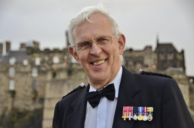 """Alasdair Hutton, known as the 'voice' behind the Royal Edinburgh Military Tattoo, has been given the title """"Legend"""" by his former school in Australia."""