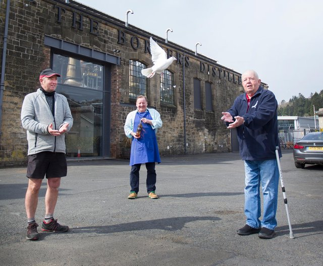 Borders Distillery founder and director John Fordyce, releases a pigeon with racing federation joint secretary Harry Keddie and president Mike Upton (picture by Bill McBurnie)