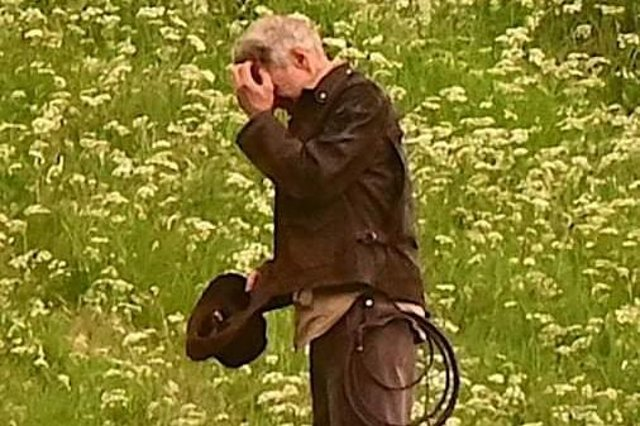 Harrison Ford, as Indiana Jones, looks as though he's fighting Borders midges in his new film, shooting at Leaderfoot Viaduct last night. Photo: Neil Renton.