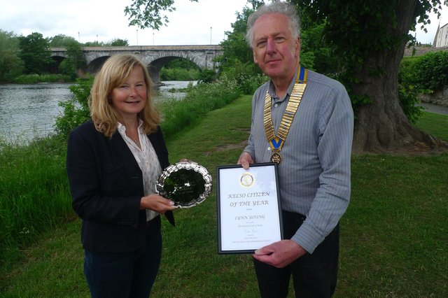 Lynn Young is presented with her award by Kelso Rotary Club president Ian Ross.