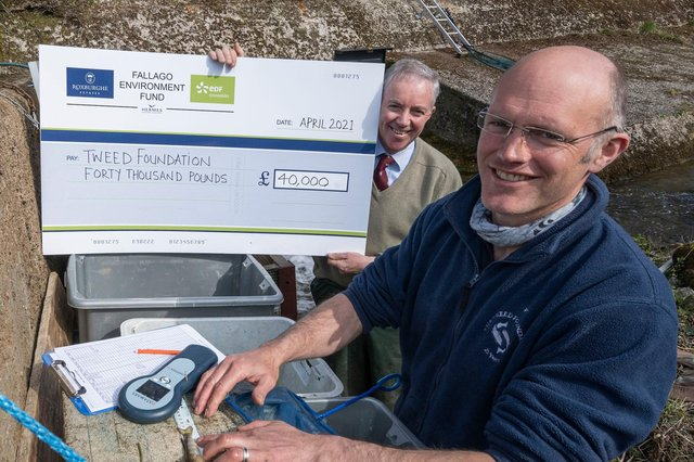 Fallago Environment Fund chairman Gareth Baird presents a cheque for £40,000 to Tweed Foundation biologist, James Hunt to help fund a smolt-tracking survey that aims to improve Atlantic Salmon stocks on the River Tweed. The young migrating salmon will be fitted with tiny acoustic tags and monitored as they head downstream with the aim of identifying future strategies that ensure as many as possible make it out to sea. Photo: Phil Wilkinson.